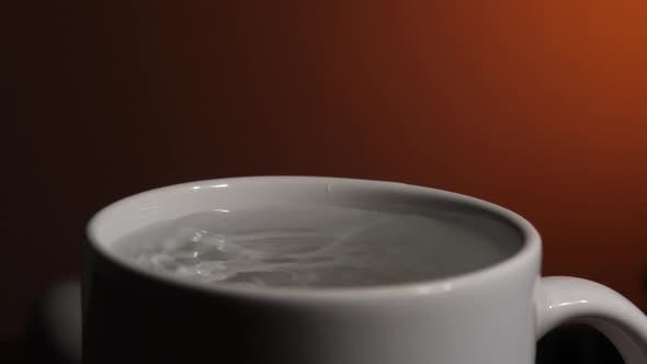 Water Dropping in Cup
