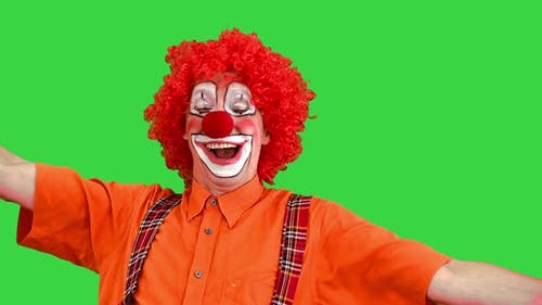 Colorful Clown Yawning and Looking To Camera on a Green Screen Chroma Key
