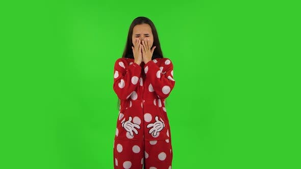 Thumbnail for Beautiful Girl in Red Fleece Pajamas Is Yawning, Bedtime Concept. Green Screen