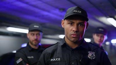 Policeman Posing at Camera
