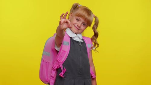 Smiling Schoolgirl Looking Approvingly at Camera Showing Ok Gesture Like Sign Positive Good Reply