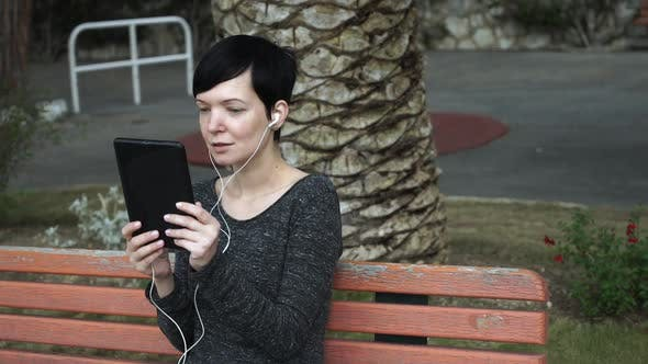 Thumbnail for Woman Using App on Touch Screen Tablet for Video Call at Playground