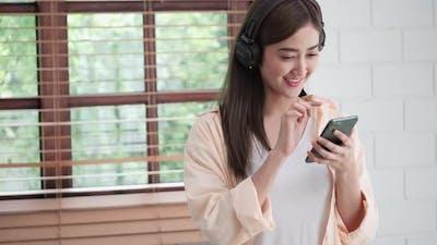 Woman enjoy listening with smartphone