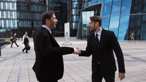 Thumbnail for Businessman Shaking Clown Hand of Partner