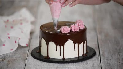 The Pastry Chef Prepares and Decorates the Cake at Home