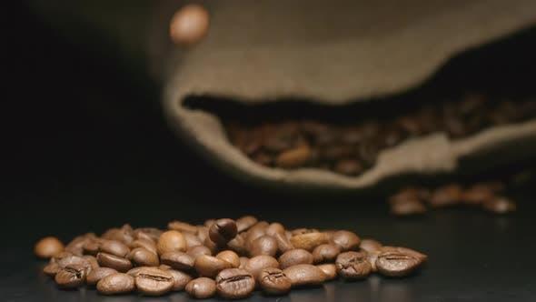 Thumbnail for Coffee Beans Fall Near A Lying Cloth Bag