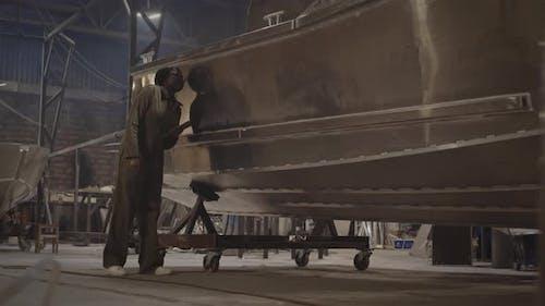 Female Engineer Checking Boat Framework
