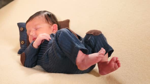 Thumbnail for Childhood, Infancy, Parenthood, Motherhood. Adorable and Cute 10-Days Newborn Baby Boy Lying on