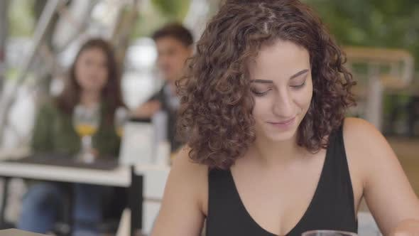 Thumbnail for Pretty Young Curly Woman Eating Tasty Meat Dish with Potato at Street Cafe