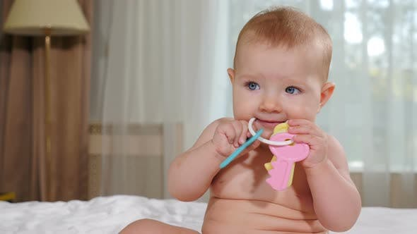 Thumbnail for Welcoming Mortgage Services. Lovely Baby Girl Playing with Toy Keys at Home in Bedroom Looking at