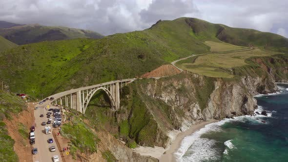 Thumbnail for Scenic Aerial Footage of a Beautiful Coastline and Striking Bixby Creek Bridge Across the Canyon.