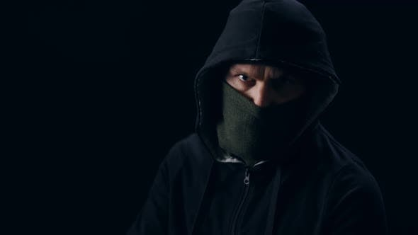 Masked Thief Aiming with Gun