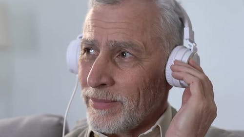 Aged Male in Headphones Listening to Music, Moving in Rhythm, Modern Style