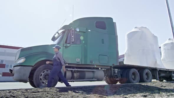 Thumbnail for Female Driver Leaving Tractor-Trailer