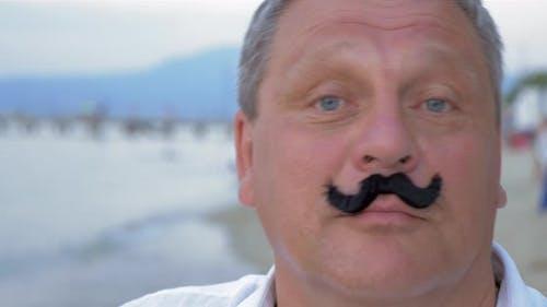 Senior Man with Fake Mustache