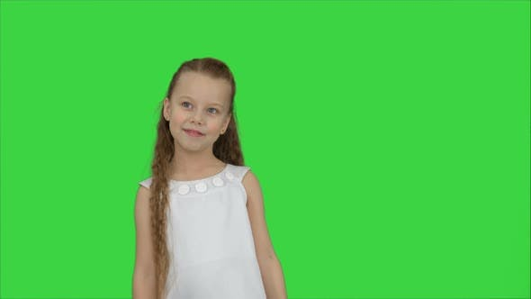 Thumbnail for Happy Beautiful Little Girl Posing To a Camera on a Green Screen, Chroma Key