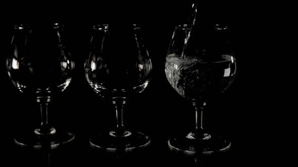 Thumbnail for Four Wineglasses Filled with Liquid