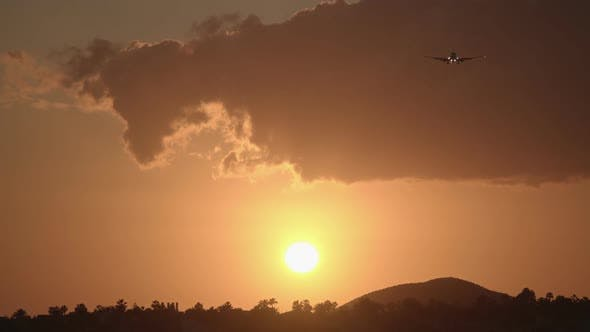 Thumbnail for Evening Sky with Golden Sun and Flying Airplane