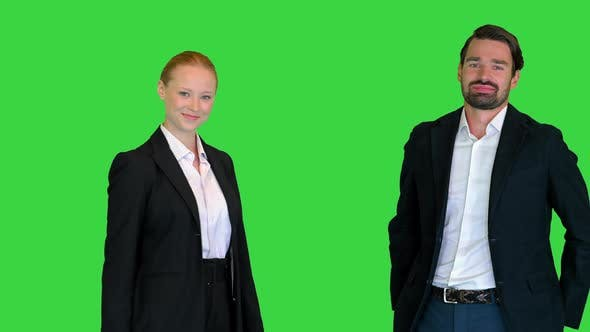 Businessman And Businesswoman Shaking Hands on a Green Screen Chroma Key