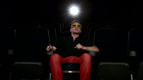 Man Watching Movie Alone in Empty Theater Auditorium, 3D Stereo Glasses