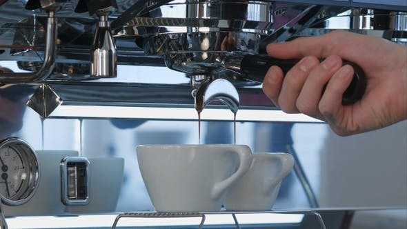 Thumbnail for Espresso coffee pouring from espresso machine