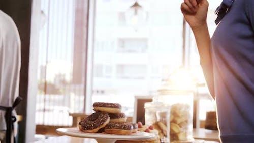 Woman looking at tempting doughnuts