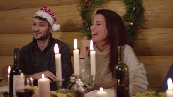 Thumbnail for Young people having fun at the Christmas dinner