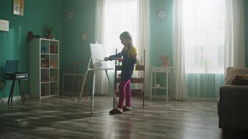 Inspired Small Girl Is Painting