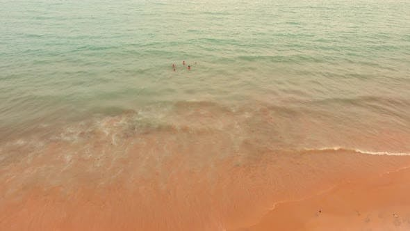 Thumbnail for Aerial view of people swimming in sea in Brazil.