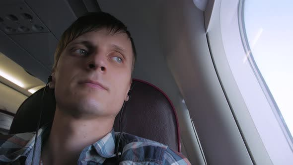 Thumbnail for Man In Headphones Sleep In Plane