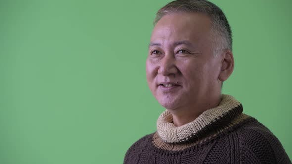 Thumbnail for Closeup Profile View of Happy Mature Japanese Man Smiling and Ready for Winter