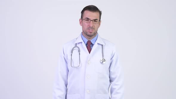 Thumbnail for Young Stressed Hispanic Man Doctor Giving Thumbs Down