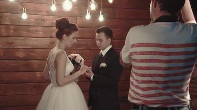 Photographer Photographs Newlyweds During the Wedding Ceremony
