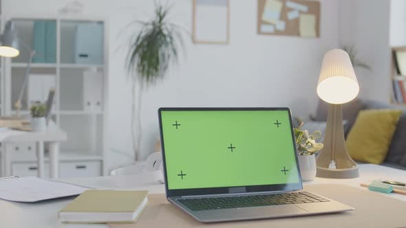 Laptop with Chroma Key Monitor on Office Table
