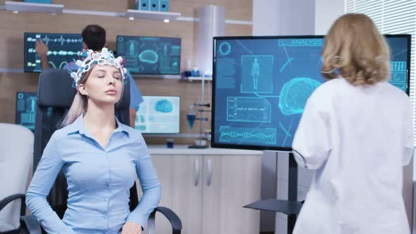 Cover Image for Female Patient with in a Neuroscience Clinic with Brains Sensors