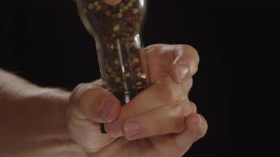 Similar Spices On A Black Background In Hand.
