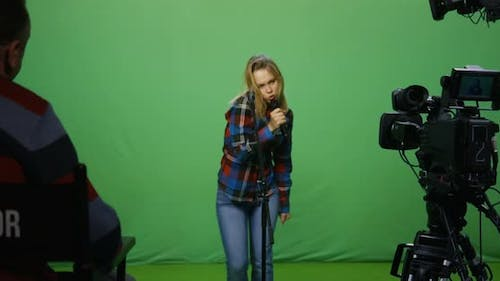 Woman Singing at an Audition