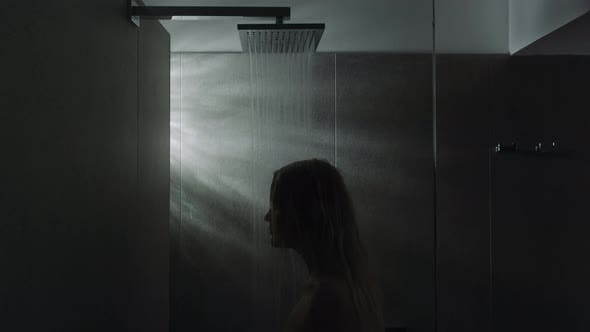 Woman under the shower. Calming down with water