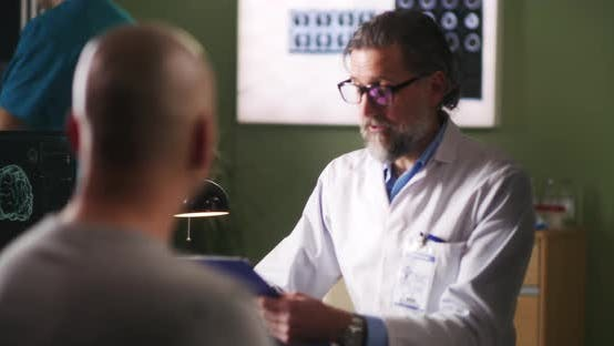Oncology Patient Meeting with Doctor in Clinic