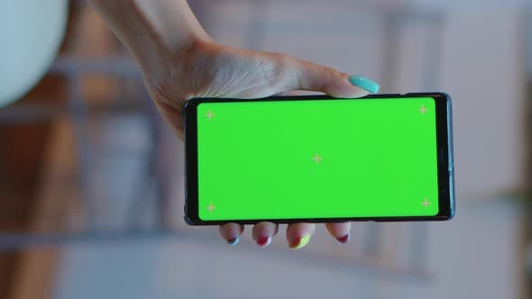 Thumbnail for Vertical Video: Housewife Holding Smartphone with Green Screen