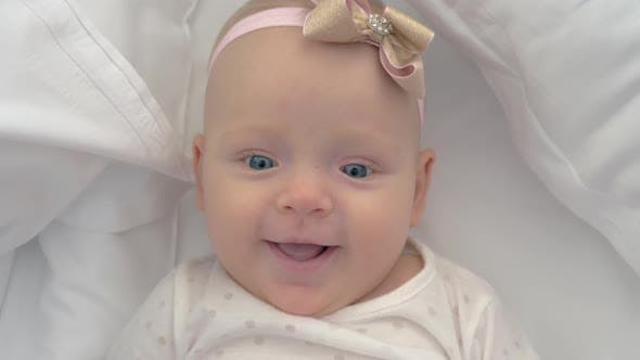 Thumbnail for Portrait of Smiling Blue-eyed Baby Girl of Six Months Old
