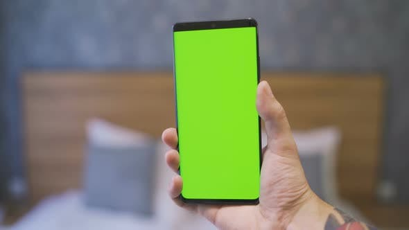 Thumbnail for Close Shot of Man Hand Holding a New Model Black Mobile Phone with Green Screen
