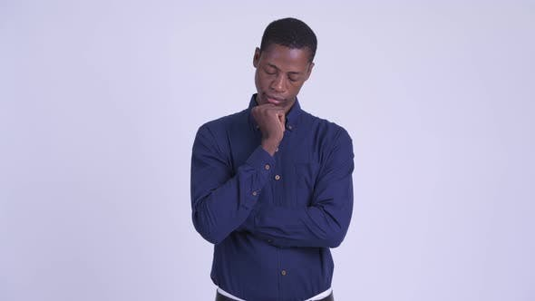 Young Serious African Businessman Thinking and Looking Down