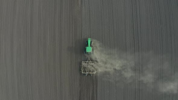 Thumbnail for Aerial View of Tractor Harrowing Soil in Field