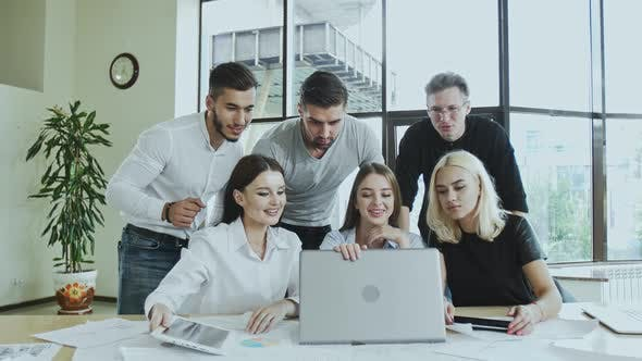 Thumbnail for A Group of Young Men and Women Are Busy Working on a Laptop Time Is Not Waiting Employees Are