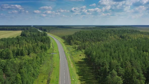 Thumbnail for Aerial Top View of Country Road in Forest