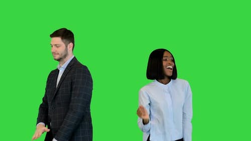 Joyful Carefree Businessman and African Businesswoman Dancing Have Fun Cheering to Project Profit on