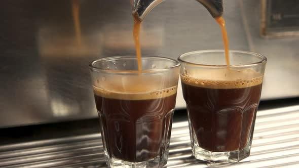 Coffee Maker Fills Glasses.