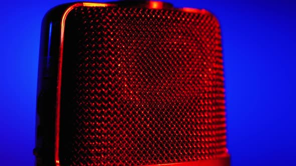Thumbnail for Condenser Microphone Rotates with Blue and Red Backlight. Professional Audio Recorder Close-up