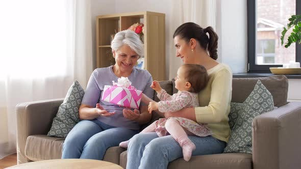 Thumbnail for Mother and Daughter Giving Grandmother Present